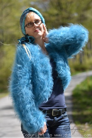 Hand knitted soft and silky mohair bolero in turquoise