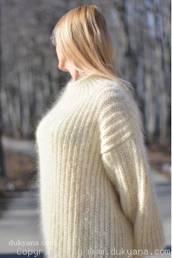 Mens knitted sweater with a mock Tneck in cream