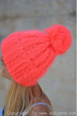 Warm winter ski hat with pompon