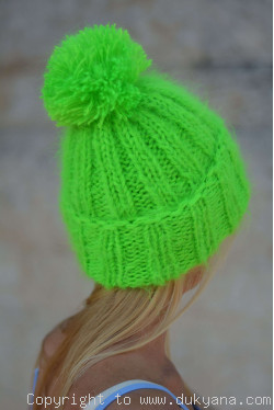 Warm winter ski hat with pompon