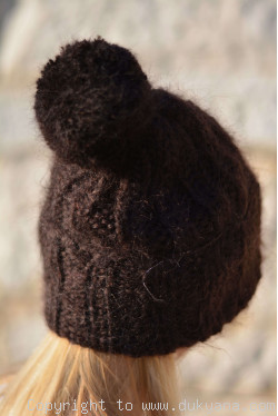 Chunky winter ski hat with pompon knitted in chocolate brown