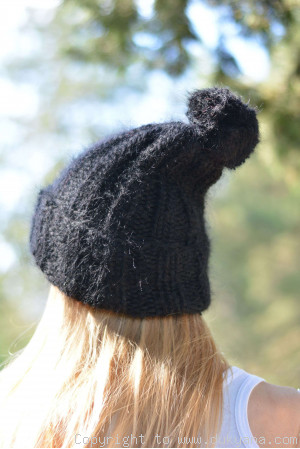 Warm winter ski hat with pompon knitted in black