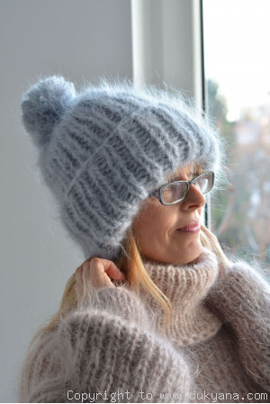 Chunky winter ski hat with pompon knitted in light gray