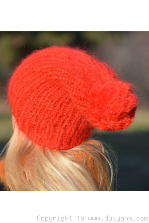 Warm winter ski hat with pompon knitted in bright red