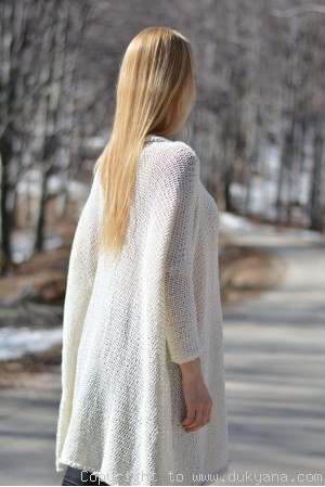 Hand knitted super soft and slouchy summer sweater in cream