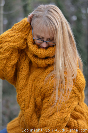 Oversized chunky cabled wool sweater in mustard yellow