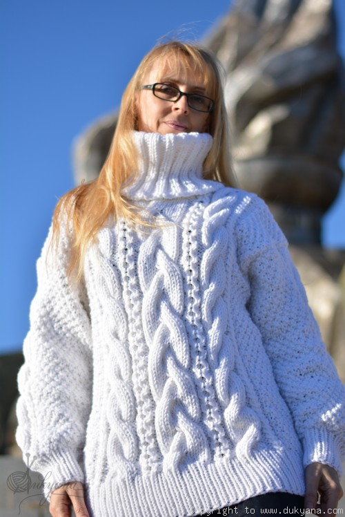 On request Hand knitted merino blend T-neck cabled wool sweater in white
