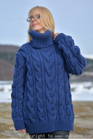 Hand knitted chunky T-neck cabled wool blend sweater in cerulean blue