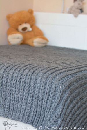 Hand knitted chunky machine washable wool blanket