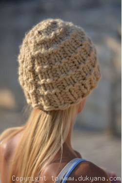 Warm and soft knitted beanie in camel beige