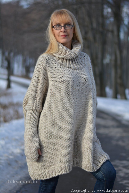 Knitted alpaca wool blend poncho in oatmeal