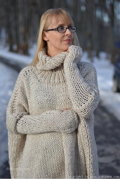 Knitted alpaca wool blend poncho in oatmeal